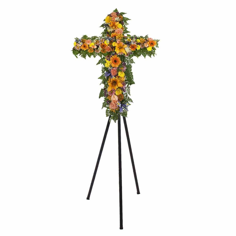Cruz pequeña con 3 rosas rosadas, lilums, claveles y gerberas en trípode Recuerdos Rosatel