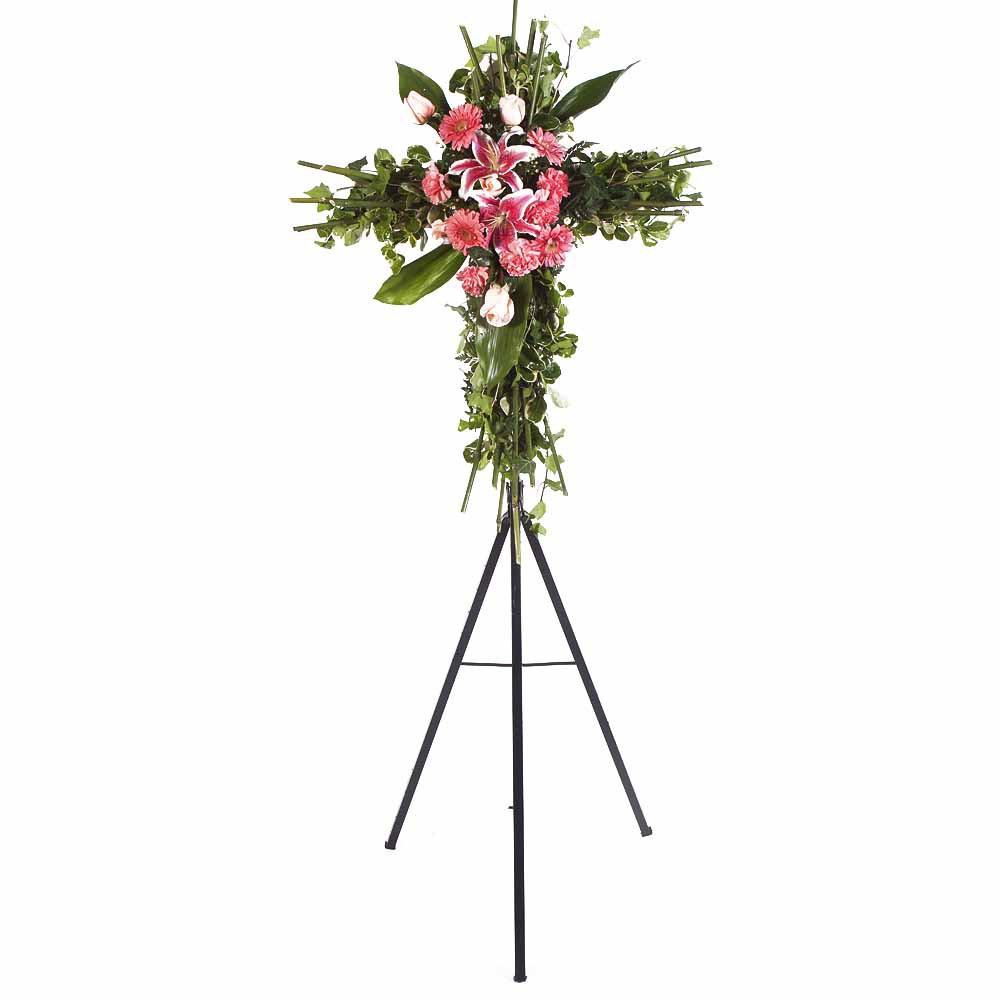 Cruz pequeña con 5 rosas rosadas, claveles y gerberas en trípode Recuerdos Rosatel