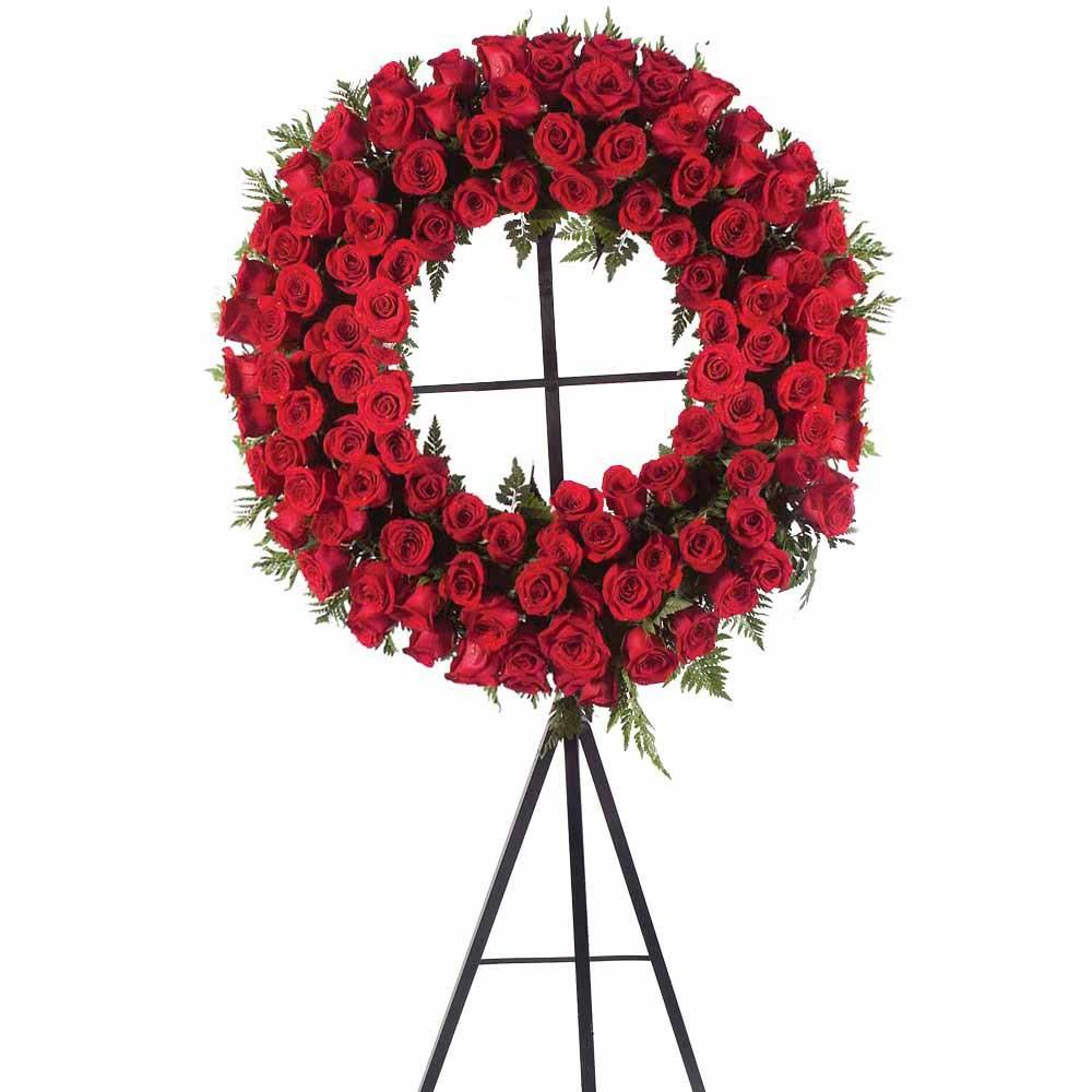 Corona con 100 rosas rojas y follaje con trípode Recuerdos Rosatel
