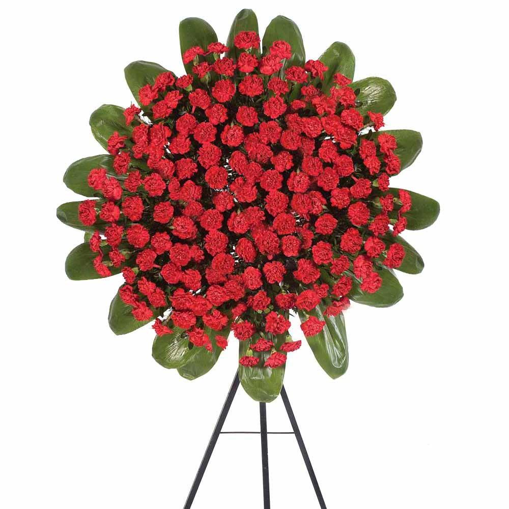 Corona con 120 claveles rojos y follaje con trípode Recuerdos Rosatel