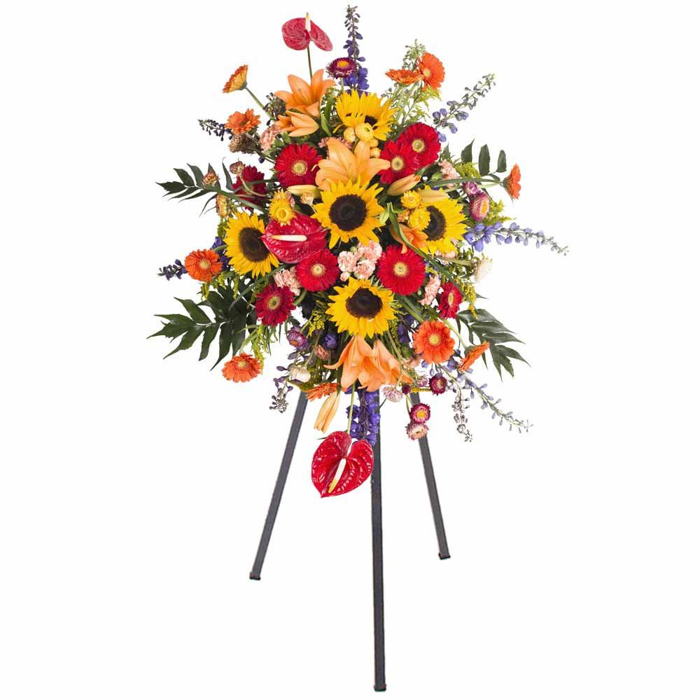Lágrima c/ trípode con gerberas, girasoles y flores variadas Recuerdos Rosatel